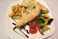 Piadina - handmade flat bread filled with mozzarella, pesto and tomato or on your request
